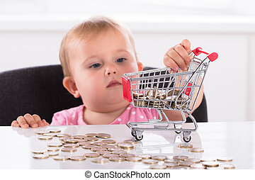 Baby Carrying Coin In Shopping Trolley