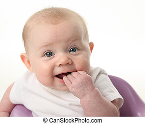 Close up portrait of a cute baby chewing on fingers, isolated on white