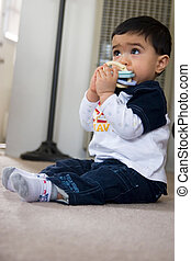 baby chewing on teething toy - Baby biting on teething ring