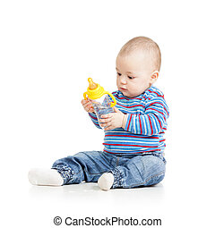baby child drinking from bottle