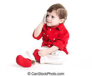 Baby child holding a mobile phone