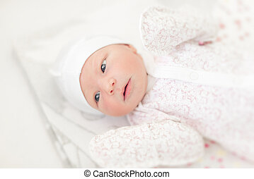 Baby close-up in a baby cot. - Baby girl close-up in a baby ...