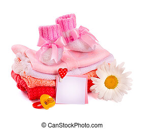 baby clothes and flower on a white background
