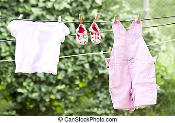 Baby clothes hanging