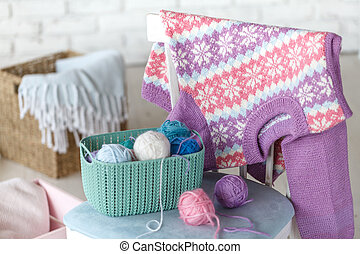 Baby clothes on chair in white room