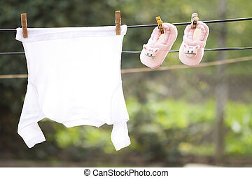 Baby clothes on the clothesline