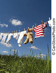 Baby clothing on a clothesline - Baby Clothing and a ...