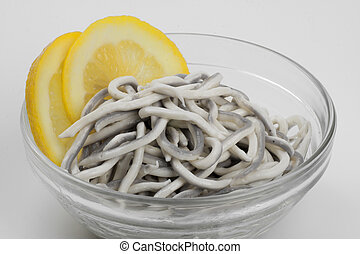 Baby Conger eel in olive oil, served with lemon