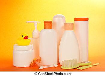 Baby cosmetics, hairbrush and cotton stick