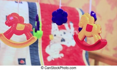 Baby cot with hanging  toys.