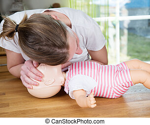 Baby CPR check for signs of breathing - Woman performing CPR...