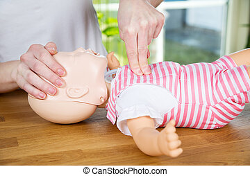Baby CPR one hand compression - woman performing CPR on baby...
