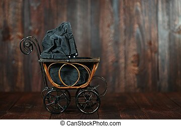 Baby Cradle on Grunge Wooden Background - Antique Infant...