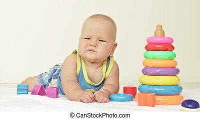 Baby crashes toy pyramid