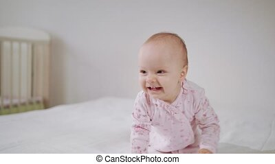Baby Crawling on All Fours on the Bed