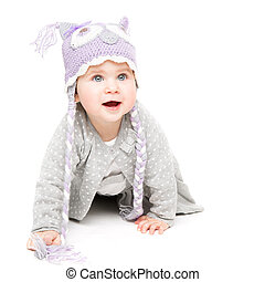 Baby Crawling on White Background, Happy Kid in Wool Hat, Beautiful Girl Portrait One Year Old