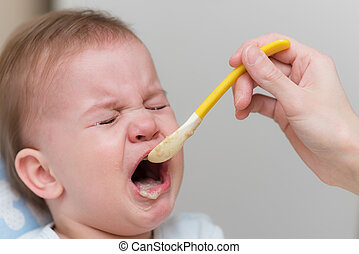 Baby cries and refuses to eat vegetable puree
