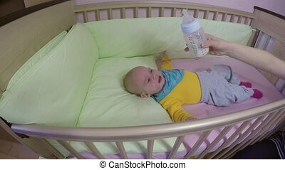 baby cry eat milk bottle
