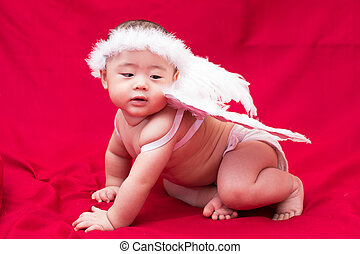 Baby cupid on red background
