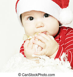 Baby, cute happy child in red, face closeup