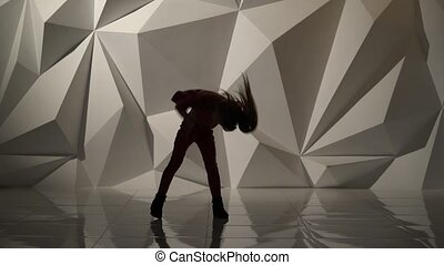 Baby dances hip hop . Silhouette. Geometrical abstract background