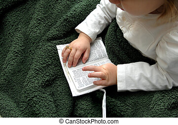 Baby Devotions - Little girl holds a small white new...