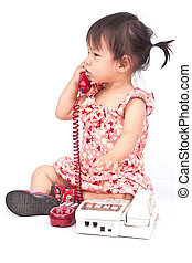 Baby dialing old beige phone calling mom isolated on white
