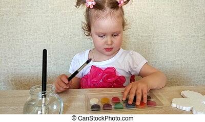 Baby draws watercolor - The girl draws watercolor....