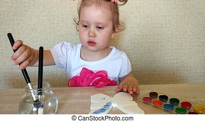 Baby draws watercolor - The girl draws watercolor....