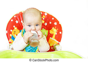 baby drinking from bottle sitting in high chair on a white background