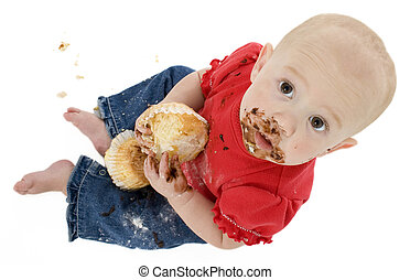 Baby Eating Cake - Baby eating cake, making mess on face.