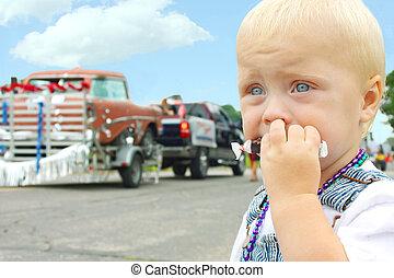 Baby Eating Candy at Parade