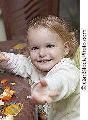 Baby eating mandarins