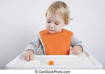 baby eating rice and carrot