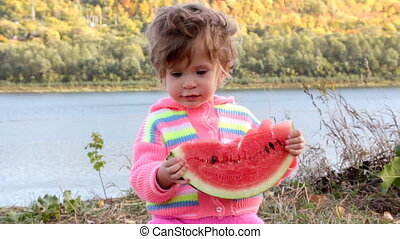 baby eating ripe watermelon