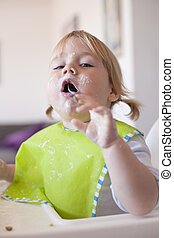 baby eating spoon in mouth