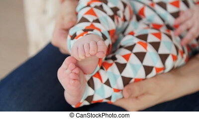 Baby feet in mother hands. Mom and her Child concept