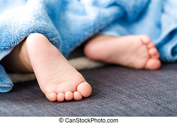Baby feet with towel