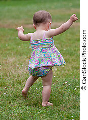 Baby first steps - Baby girl taking first steps
