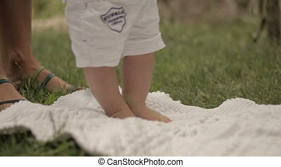 Baby first steps on grass