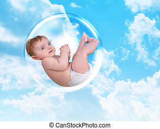 Baby Floating in Protection Bubble - A young white baby is...