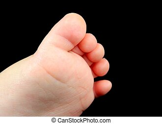Baby foot on a black background