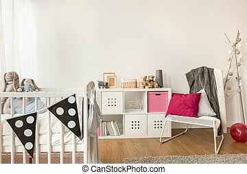 Baby furniture in girl's room