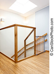 Baby gate on a staircase - Protective baby gate on a modern...