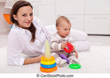 Baby girl and her mother playing