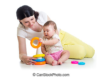 baby girl and mom playing together with toy