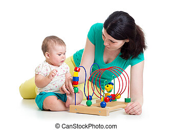 baby girl and mother play with educational toy