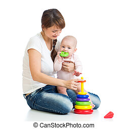 baby girl and mother playing together