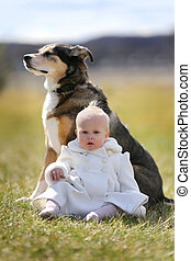 Baby Girl and Pet Dog Outside in Spring