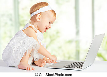 baby girl at  laptop computer